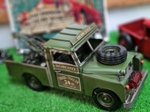 Green tow model tow truck with winchon front and spare tire on bonnet hobcote truck trailer 24 hours on door